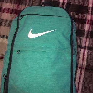 Turquoise Nike backpack